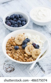healthy breakfast with cottage cheese, granola and berries, top view