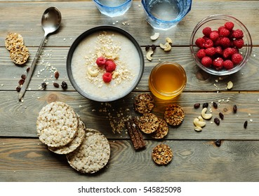 Healthy breakfast. Crispbread, raspberries and honey on the table, wooden background
