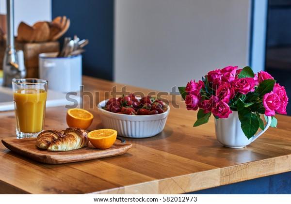 Healthy breakfast with croissant, orange juice, fresh berries. Country breakfast concept.