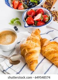 Healthy breakfast - croissants, muesli and berries