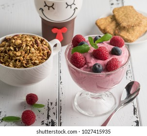 Healthy breakfast: Curd souffle with fresh blueberry, raspberries,multiseed biscuits, granola and tea