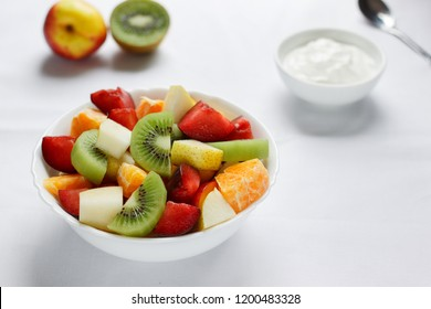 Healthy breakfast with fresh fruits and yogurt.