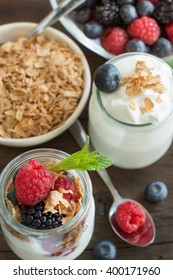 Healthy breakfast with Fresh greek yogurt, muesli and berries