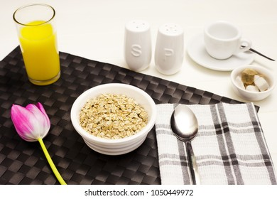 A healthy breakfast of fresh orange juice, oatmeal and coffee