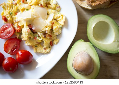 Healthy breakfast full of proteins and vitamins with omlette, cherry tomatoes and avocado