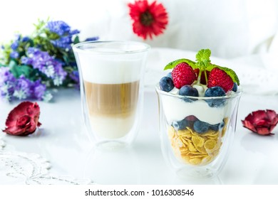 Healthy breakfast full of vitamins and probiotics. Yoghurt, cornflakes and fruit.