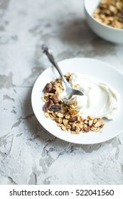 healthy breakfast: granola with cranberries and cheese on the plate