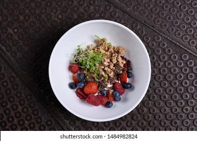 Healthy breakfast, granola with forrest berries