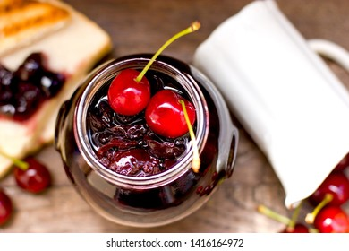 Healthy breakfast, homemade make cherry jam - marmalade and tost