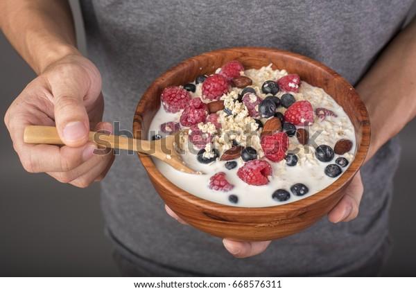 Healthy breakfast ingredients in man hand, Healthy food concept