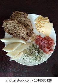 Healthy breakfast: meat, cheese, fruit, greens and bread
