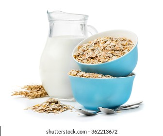 A healthy breakfast, a mixture of cereal flakes, muesli in blue bowls and milk jug isolated on white background
