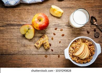 Healthy breakfast. Muesli with apple,raisins, muesli bar and milk top view
