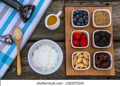 Healthy Breakfast Muesli Quark or Cottage Cheese Preparation Ingredients, Strawberries, Blueberries, Blackberries, Dried Cranberries, Laid Out on a Wooden Table: Budwig Cancer Protocol Diet Ingredient