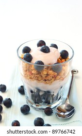 Healthy breakfast with muesli, yogurt and blueberries in a glass