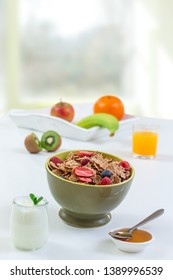 Healthy breakfast with natural yogurt, muesli and berries on white wooden background, closeup,