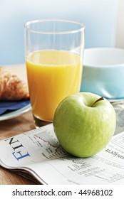 healthy breakfast and newspaper