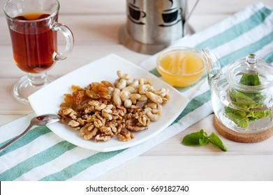 Healthy breakfast: nuts mix and mint tea.