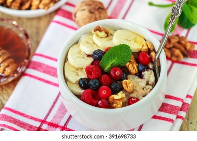 Healthy Breakfast. Oatmeal with fresh berries, bananas nuts and honey
