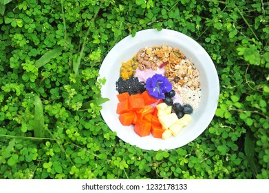 Healthy breakfast on grass background.