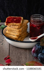 healthy breakfast: rusks with homemade plum and hazelnuts jam
