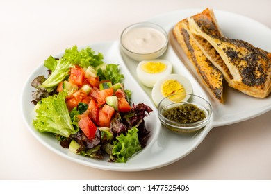 Healthy breakfast with salad and boilled eggs