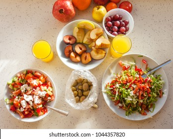 Healthy breakfast with salad, fruits and orange juice