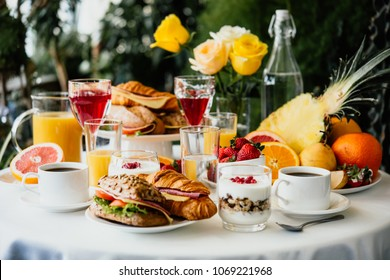 Healthy breakfast served with coffee, frouts and sandwiches