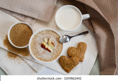 Healthy breakfast. Sesame dry cookies in the form of heart porridge of amaranth with apples  and yogurt.