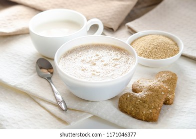 Healthy breakfast. Sesame dry cookies in the form of heart porridge of amaranth and yogurt.
