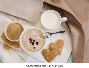 Healthy breakfast. Sesame dry cookies in the form of heart porridge of amaranth with strawberries and yogurt.