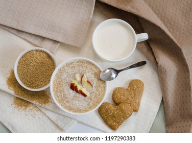 Healthy breakfast. Sesame dry cookies in the form of heart porridge of amaranth with apples  and yogurt.