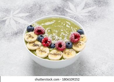 Healthy Breakfast smoothie in a bowl with hemp protein, avocado, banana, coconut, raspberries, blueberries and Chia seeds.