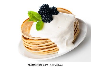 healthy breakfast: a stack of homemade pancakes with fresh blackberries and whipped cream, fruit, and coffee on a white background, isolated