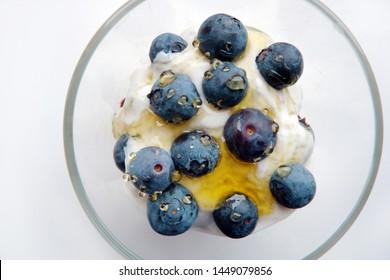 healthy breakfast, summer fruits, yoghurt, blueberries and barley cereal
