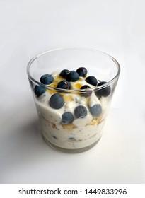 healthy breakfast, summer fruits yoghurt, blueberries and barley cereal