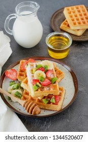 Healthy breakfast table with belgian waffles, exotic fruits and coffee