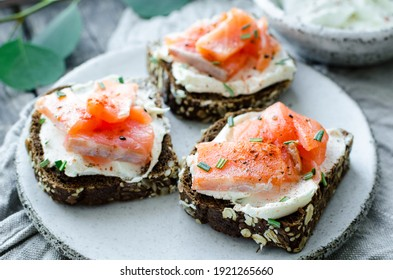 Healthy breakfast - toast with rye bread, salmon and cream cheese. Healthy snack concept.