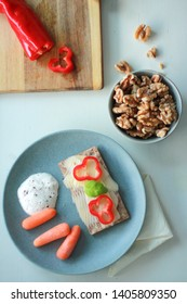 Healthy breakfast with walnuts, crispbread with cheese, carrots and skyr dip