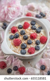 Healthy breakfast with yogurt, granola and berries