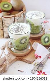 Healthy breakfast: yogurt, kiwi and Chia seeds. Focus selective