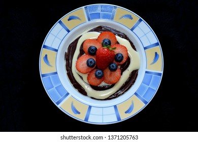 Healthy breakfest for good start, vanilla and chocolate puding with fruits