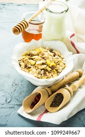 Healthy brekfast concept with  oatmeal, superfood, honey and milk on rustic background with copy space