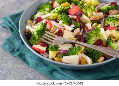 healthy broccoli salad with apple onion dried cranberries pistachio. vegan low carb diet