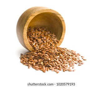 Healthy brown linseeds isolated on white background.