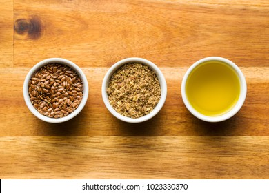 Healthy brown linseeds, minced linseed and oil.