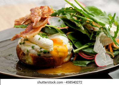 Healthy Brunch Breakfast with Wholemeal Bread Toast and Poached Egg with Green Salad