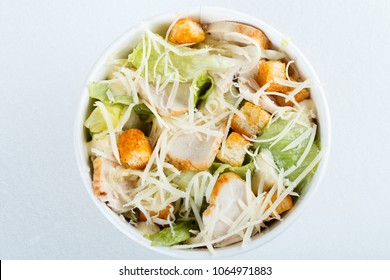 Healthy caesar salad with chicken, eggs, cheese and croutons. Italian cuisine. Top view