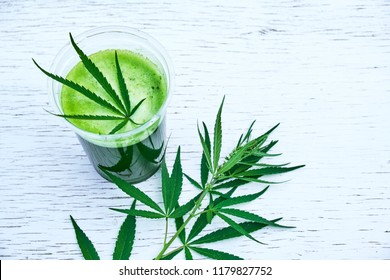 Healthy cannabis smoothie on wooden background. Natural supplement, detox and healthy living