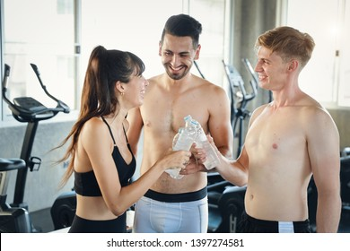 healthy caucasian fitness man and woman drinking pure water with happy smiling face